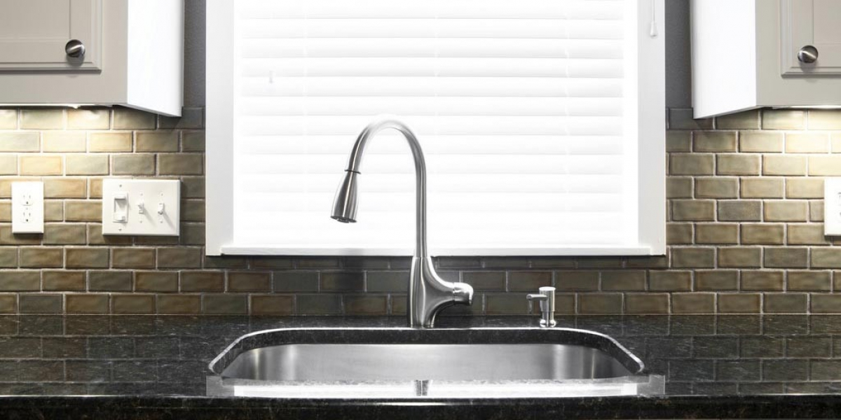 how to fix a clogged kitchen sink in a condo